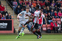 Sam Jones of Grimsby tries to get past Emmanuel Onariase of Cheltenham Town during the Sky Bet League 2 match between Cheltenham Town and Grimsby Town at the The LCI Rail Stadium,  Cheltenham, England on 17 April 2017. Photo by PRiME Media Images / Mark Hawkins.