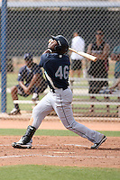 Julio Morban #46 of the Seattle Mariners plays in a minor league spring training game against the San Diego Padres at the Padres minor league complex on March 19, 2011  in Peoria, Arizona. .Photo by:  Bill Mitchell/Four Seam Images.