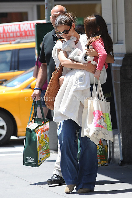 WWW.ACEPIXS.COM . . . . . .July 8, 2012...New York City....Katie Holmes and  Suri Cruise leaving Whole Foods on July 8, 2012 in New York City. ....Please byline: KRISTIN CALLAHAN - WWW.ACEPIXS.COM.. . . . . . ..Ace Pictures, Inc: ..tel: (212) 243 8787 or (646) 769 0430..e-mail: info@acepixs.com..web: http://www.acepixs.com .