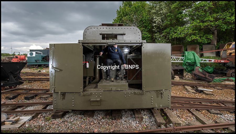 BNPS.co.uk (01202 558833)<br /> Pic: PhilYeomans/BNPS<br /> <br /> Leighton Buzzard railway volunteer Tony Tomkins at the rudimentary controls.<br /> <br /> Old War Horse...back on track.<br /> <br /> The last surviving armoured locomotive used to pull munitions to the front line in World War One has been painstakingly restored a century later.<br /> <br /> Volunteers at the Greensand Trust based in Leighton Buzzard have spent the past decade bringing the historic Simplex 40HP engine back to full working order as part of a £20,000 project.<br /> <br /> The 8ft high, 10ft long loco, resembling a tank, was built in Bedford in 1917 and encased in full armour plating to protect it's plucky driver from enemy shell fire on the Western Front.<br /> <br /> It's petrol engine made it more discreet to use at night close to the front line than larger, noisier and more visible steam trains, which were easier targets for the German guns.<br /> <br /> In a world before health and safety the brave driver sat on the noisy engine, with the petrol tank and a radiator next to him in a fume filled cabin - but despite these privations he was infinitely safer inside than out.
