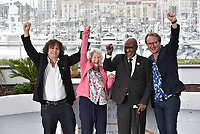 CANNES, FRANCE - MAY 14: (L-R) Director Nicolas Champeaux, guest, Andrew Mlangeni and producer William Jehannin raise fists as they attend the photocall for the 'The State Against Mandela' during the 71st annual Cannes Film Festival at Palais des Festivals on May 14, 2018 in Cannes, France. <br /> CAP/PL<br /> &copy;Phil Loftus/Capital Pictures