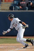 Greg Velazquez #24 of the Cal State Fullerton Titans bats against the Loyola Marymount Lions at Goodwin Field on February 29, 2012 in Fullerton,California. Cal State Fullerton defeated LMU 6-2.(Larry Goren/Four Seam Images)