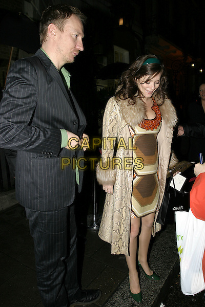 ANNA FRIEL .Artists Independent Network's Pre-BAFTA Party, Annabel's, Berkley Square, London, February 11th 2005..full length pregnant cleavage printed dress green snakeskin coat fur collar cuffs.Ref: AH.www.capitalpictures.com.sales@capitalpictures.com.©Capital Pictures.