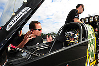 Jan. 17, 2012; Jupiter, FL, USA: NHRA funny car driver Jack Beckman (left) talks with top fuel dragster driver Tony Schumacher during testing at the PRO Winter Warmup at Palm Beach International Raceway. Mandatory Credit: Mark J. Rebilas-
