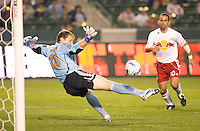 Chivas USA Goal Keeper Brad Guzan gets his outstretched leg on the ball deflecting it over the top of the goal during a 0-0 tie between the Chivas USA vs New York Red Bulls in a game at The Depot Center in Carson, California Saturday, April, 29, 2006.
