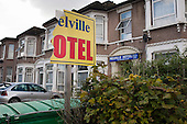 Torn sign outside a B&B hotel, Ilford, used to house homeless families.