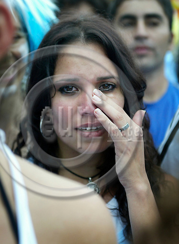BERLIN - GERMANY -- 30. JUNE 2006. An Argentinean football female fan crying during the match between Germany and Argentina. Photo: Uffe Noejgaard / EUP-IMAGES