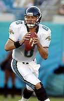 Jacksonville Jaguar quarterback Mark Brunell (#8) looks for an open receiver  during an NFL preseason game in Jacksonville, FL on Friday, August 15, 2002.  Tampa bay won the game 20 to 0.(Photo by Brian Cleary/ www.bcpix.com )