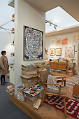 London, England. 15 October 2014. The curated stand of Helly Nahmad Gallery shows an art collector's appartment in the 1960's with art displayed on the walls. Fine art fair Frieze Masters 2014 in Regent's Park, London. Photo: Bettina Strenske