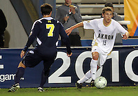 Scott Caldwell #15 of the University of Akron pulls away from Chase Tennant #7 of the University of Michigan during the 2010 College Cup semi-final at Harder Stadium, on December 10 2010, in Santa Barbara, California. Akron won 2-1.