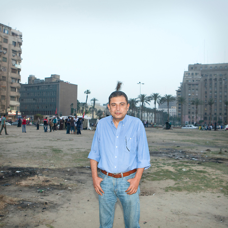Egypt / Cairo / 4.4.2013 / Adel Wassily, Egyptian photographer, poses in Tahrir square in Downtown Cairo. © Giulia Marchi