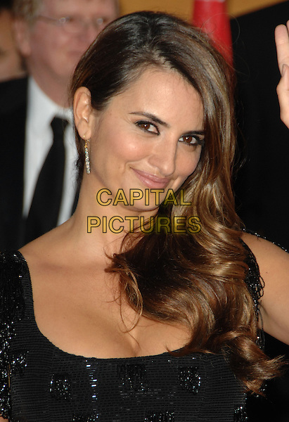 PENELOPE CRUZ.Arrivals at the 16th Annual Screen Actors Guild Awards Held At The Shrine Auditorium in Los Angeles, California, USA..January 23rd, 2010 .SAG SAGs headshot portrait black beads beaded cleavage silver earring .CAP/RKE/DVS.©DVS/RockinExposures/Capital Pictures