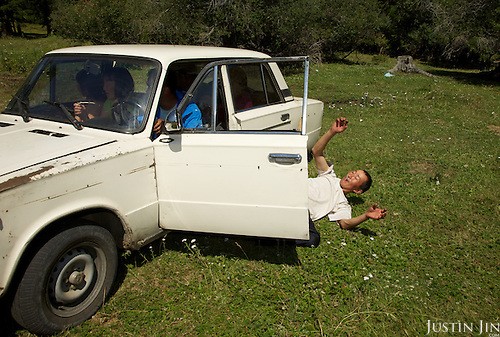Orlan, drunk on vodka on his 35th birthday, falls out of his Lada car in the taiga outside the Tuva Republic capital of Kyzyl.  Orlan (Tuvans normally use just one name) owns about 50 sheep, goats and milking cows. Like many other animal herders in the republic, Orlan prefers traditional farming methods but finds it difficult to compete in modern society. Alcoholism is rife in the region.