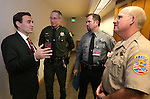Nevada Attorney General Adam Laxalt, left, talks with Washoe County Sheriff Chuck Allen, Nevada Department of Wildlife Chief Game Warden Tyler Turnipseed and Douglas County Sheriff Ron Pierini during a law enforcement summit in Carson City, Nev., on Thursday, Feb. 5, 2015. <br /> Photo by Cathleen Allison