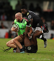 DURBAN, SOUTH AFRICA - MAY 05: S'busiso Nkosi and Lwazi Mvovo of the Cell C Sharks looks to tackle Matt Faddes during the Super Rugby match between Cell C Sharks and Highlanders at Jonsson Kings Park Stadium in Durban, South Africa on Saturday, 5 May 2018. Photo: Steve Haag / stevehaagsports.com
