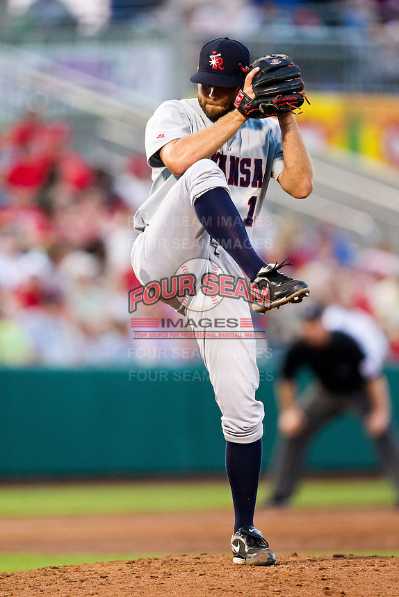 Dakota Robinson (15) of the Arkansas Travelers winds up during a game against the Springfield Cardinals at Hammons Field on May 5, 2012 in Springfield, Missouri. (David Welker/Four Seam Images)