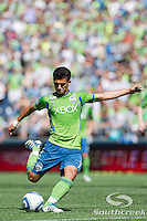 Seattle Sounders FC forward Fredy Montero (17) tries for a goal on a penalty kick in a match against Columbus Crew at CenturyLink Field in Seattle, Washington. Seattle Sounders FC won, 6-2.