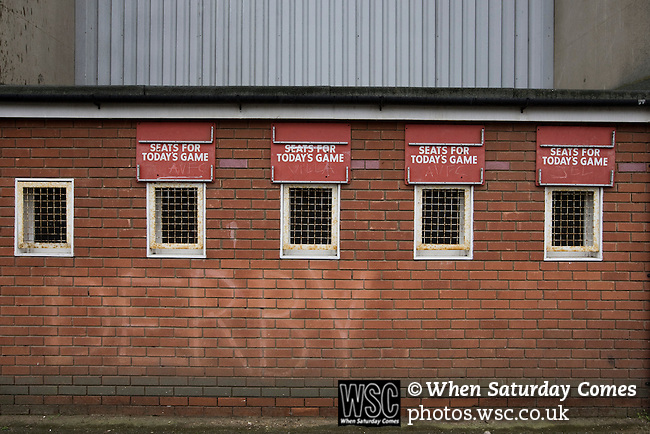 Disused ticket office windows daubed with rival's graffiti at the rear of the Brian Clough Stand at the City Ground, Nottingham on the day Nottingham Forest take on visitors Ipswich Town in an Npower Championship match. Forest won the match by two goals to nil in front of 22,935 spectators.