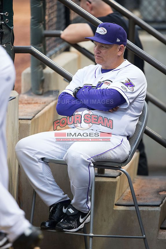 Winston-Salem Dash pitching coach J.R. Perdew (31) watches from the dugout during the game against the Myrtle Beach Pelicans at BB&T Ballpark on April 18, 2015 in Winston-Salem, North Carolina.  The Pelicans defeated the Dash 8-4 in game two of a double-header.  (Brian Westerholt/Four Seam Images)