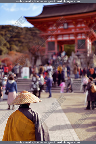 Japanese Buddhist monk in front of Kiyomizu-dera temple entrance busy with tourists. Higashiyama, Kyoto, Japan 2017.
