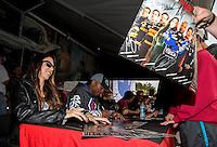 Jul. 27, 2013; Sonoma, CA, USA: NHRA funny car driver Alexis DeJoria signs autographs during qualifying for the Sonoma Nationals at Sonoma Raceway. Mandatory Credit: Mark J. Rebilas-