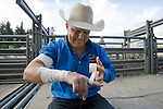 Heath Ford, World Champion Bareback Rider, from Slocum, TX,  tapes his finger before the bare back riding event at the Kitsap County Fair and Stampede held Aug. 22 to Aug. 26, 2012 in Silverdale, WA. ©2012. Jim Bryant Photo. All Rights Reserved