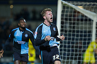 Jason McCarthy of Wycombe Wanderers celebrates scoring his goal during the Sky Bet League 2 match between Wycombe Wanderers and Oxford United at Adams Park, High Wycombe, England on 19 December 2015. Photo by Andy Rowland.