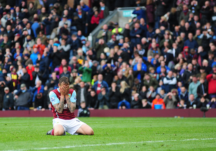 Burnley's Matthew Taylor sinks to his knees after missing from the penalty spot<br /> <br /> Photographer Chris Vaughan/CameraSport<br /> <br /> Football - Barclays Premiership - Burnley v Leicester City - Saturday 25th April 2015 - Turf Moor - Burnley<br /> <br /> &copy; CameraSport - 43 Linden Ave. Countesthorpe. Leicester. England. LE8 5PG - Tel: +44 (0) 116 277 4147 - admin@camerasport.com - www.camerasport.com
