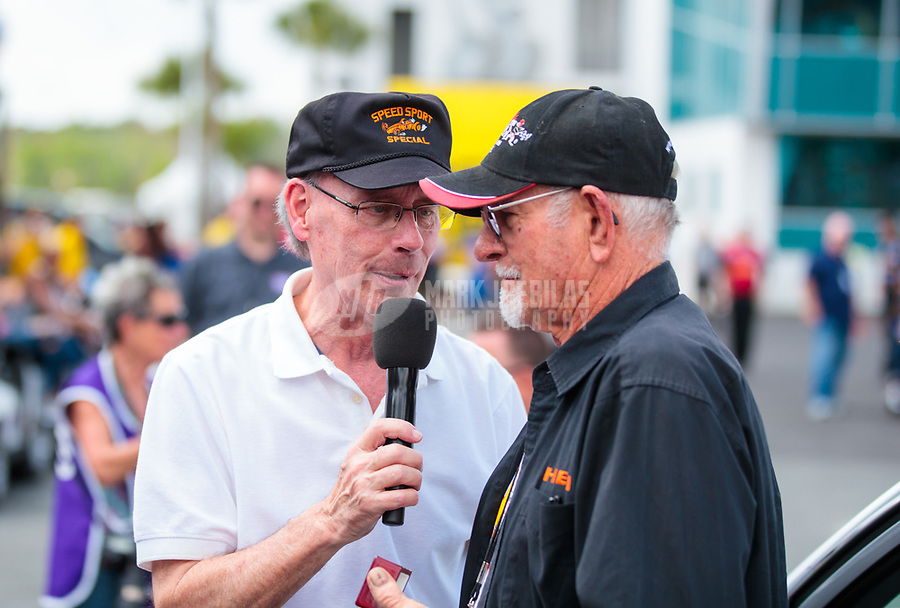 """Mar 15, 2019; Gainesville, FL, USA; NHRA driver Don Garlits (right) is interviewed by announcer Bob Frey during the Toyota """"Unfinished Business"""" legends race at qualifying for the Gatornationals at Gainesville Raceway. Mandatory Credit: Mark J. Rebilas-USA TODAY Sports"""