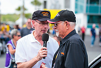 "Mar 15, 2019; Gainesville, FL, USA; NHRA driver Don Garlits (right) is interviewed by announcer Bob Frey during the Toyota ""Unfinished Business"" legends race at qualifying for the Gatornationals at Gainesville Raceway. Mandatory Credit: Mark J. Rebilas-USA TODAY Sports"