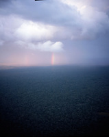 Areial photograph of sunset with rainbow over the quintana roo jungle. Photos for Jasai´s catalogue of the houses of Memo and the surrounding area