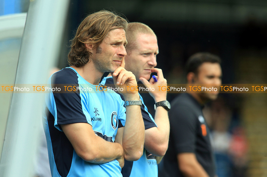 Wycombe's Player/Coach, Gareth Ainsworth & Assistant Manager, Richard Dobson share a similar pose - Wycombe Wanderers vs Fulham - Friendly Football Match at Adams Park, High Wycombe, Buckinghamshire - 28/07/12 - MANDATORY CREDIT: Paul Dennis/TGSPHOTO - Self billing applies where appropriate - 0845 094 6026 - contact@tgsphoto.co.uk - NO UNPAID USE.