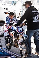 Rider an his mechanic in pit line at Spanish Motocross Championship at Albaida circuit (Spain), 22-23 February 2014