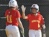 Janae Barracato #8, Sacred Heart Academy third baseman, right, gets congratulated by teammate Lauren Wasserman #11 after crossing home plate in a CHSAA varsity softball game against Kellenberg at Greis Park in Lynbrook on Tuesday, April 11, 2017. Sacred Heart won by run rule 9-0 after four and a half innings of play.
