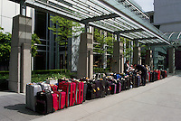 Suitcases / Luggage lined up for Travel in Orderly Row outside Hotel, Vancouver, BC, British Columbia, Canada