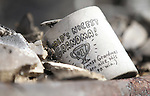 A coffee mug rests in the rubble of June Hargis' home in Pleasant Valley, south of Reno, Nev., on Saturday, Jan. 21, 2012. Hargis, 93, was the only fatality in a wind-driven brush fire which raced through the area on Thursday destroying 29 homes. (AP Photo/Cathleen Allison)