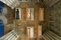 Royal tombs seen from above, with effigies of (top) thought to be Marie de Brienne, 1225-1280, Louis de France, 1275-1319, Marguerite d'Artois, d. 1311, Clementia of Hungary, 1293-1328, and (bottom) Jeanne de France, c. 1371, Blanche de Navarre, d. 1398, and Charles, count of Valois, d. 1325, in the Basilique Saint-Denis, Paris, France. The basilica is a large medieval 12th century Gothic abbey church and burial site of French kings from 10th - 18th centuries. Picture by Manuel Cohen