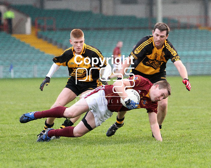 23/11/13 Clyda Rovers Gavin Carey and Chris Kenny pile the pressure on St Joseph's Seanie Malone when the two sides met in The Gaelic Grounds for the Munster Intermediate Final on Saturday. Pic Tony Grehan / Press 22