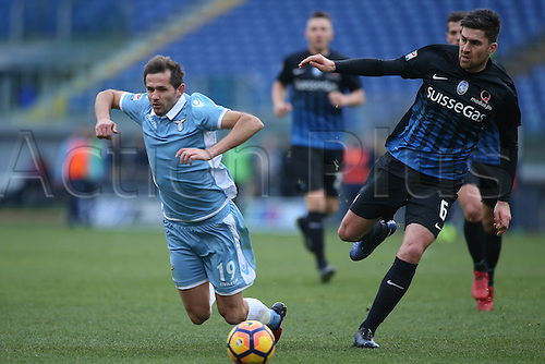 15th January 2017, Stadio Olimpico, Rome, Italy; Serie A football, SS lazio versus Atalanta;  Lulic and Zukanovic  in action during the match.