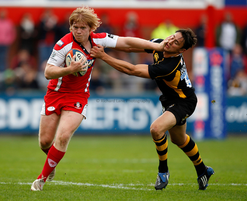 Photo: Richard Lane/Richard Lane Photography. Gloucester Rugby v London Wasps. Anglo Welsh EDF Energy Cup. 04/10/2008. Gloucester's Jack Adams is tackled by Wasps' Rob Hoadley.