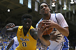 29 December 2014: Duke's Jahlil Okafor (right) grabs the ball from Toledo's Kurt Hall (0). The Duke University Blue Devils hosted the University of Toledo Rockets at Cameron Indoor Stadium in Durham, North Carolina in a 2014-16 NCAA Men's Basketball Division I game. Duke won the game 86-69.