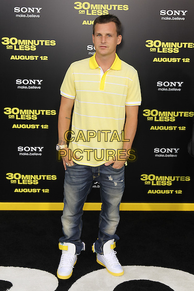 "ROB DYRDEK.World premiere of Columbia Pictures' ""30 Minutes Or Less"" at Grauman's Chinese Theatre. Hollywood, CA USA. .August 8th, 2011.full length polo top jeans denim yellow  .CAP/CEL.©CelPh/Capital Pictures"