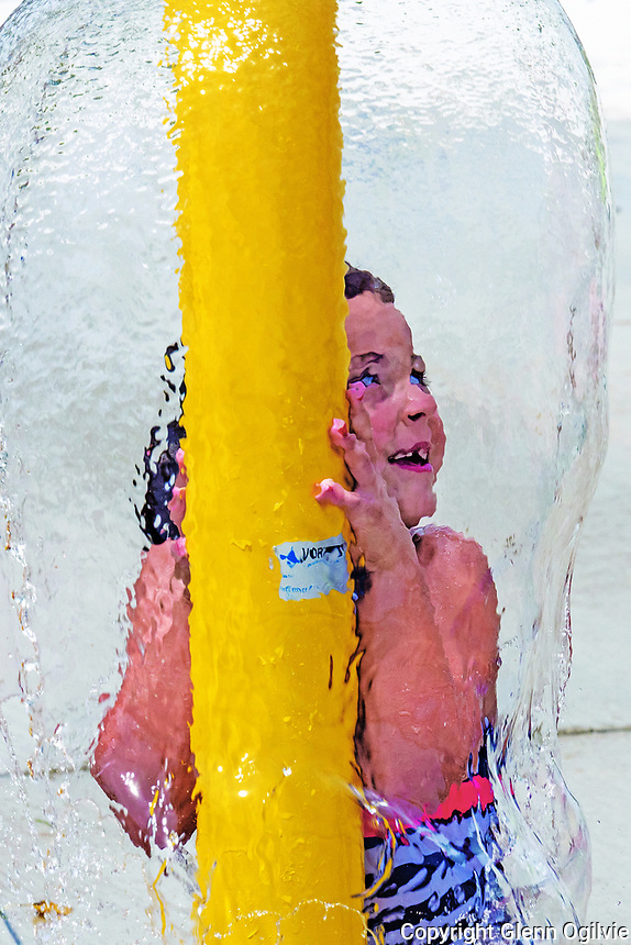 Rayah Salisbury, 6, of Sarnia finds a great way to keep cool during a heat wave at Point Edward's slash pad. She was visiting the recently opened water park with her mother, Michelle and younger brother, Blake.