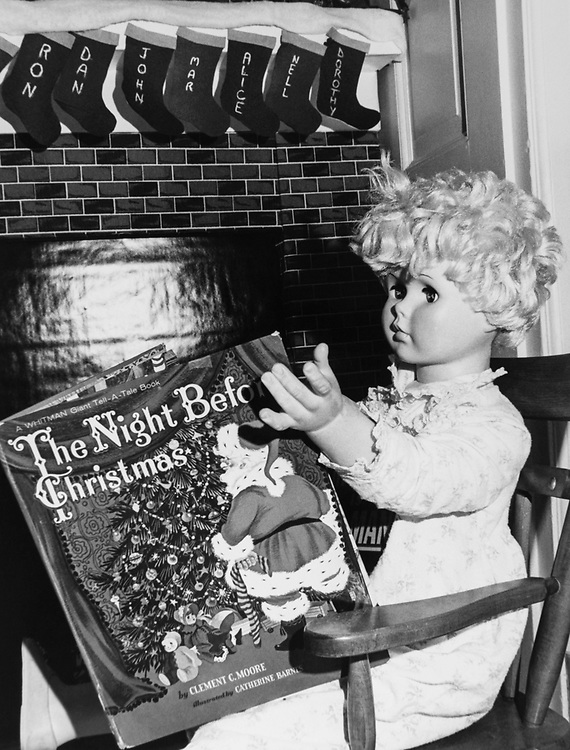 Christmas decoration with doll reading book at Congressman's office around Christmas. (Photo by Dev O'Neill/CQ Roll Call via Getty Images)