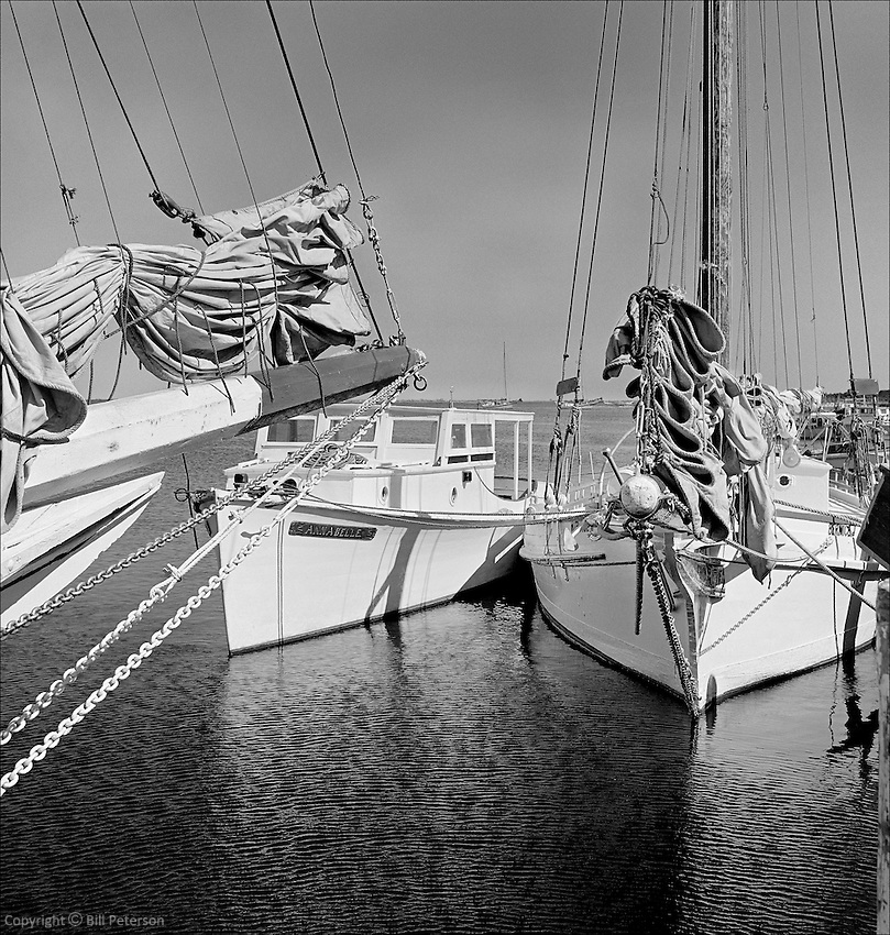 "Skipjack Bernice J and deadrise Anna Belle safely alongside in harbor, 1967. Fine Art, Limited Edition Skipjack print from the ""Skipjack Sunday"" collection."