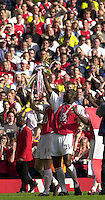 Photo. © Peter Spurrier/Intersport Images.15/05/2004  - 2003/04 Premiership Football - Arsenal v Leicester City:.Martin Keown [left] and Sol Campbell celebrate with the Trophy.[Credit] Peter Spurrier Intersport Images
