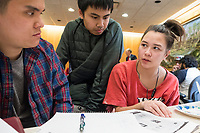Anh Bui (from left), 19, and Vattara Heng, 19, help Mary Nelson, 20, with Chemistry homework during a Lunar New Year celebration at Middlesex Community College's Asian American Connections Center on Thurs., Feb. 15, 2018. The Asian American Connections Center was established at the school using a federal grant in 2016 and serves as a focal point for the Asian community at the school, predominantly Cambodian, to gather, socialize, study, and otherwise take part in student life. Bui is of Vietnamese heritage and is a Physical Science student at MCC. Heng is a student at University of Massachusetts - Lowell, and was invited to the event by students. Nelson is of Cambodian heritage and is a Biotechnology student at MCC.