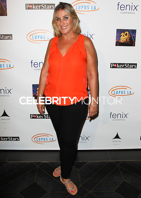 HOLLYWOOD, LOS ANGELES, CA, USA - SEPTEMBER 18: Nicole Fogel arrives at the 'Get Lucky For Lupus' 6th Annual Poker Tournament held at Avalon on September 18, 2014 in Hollywood, Los Angeles, California, United States. (Photo by Celebrity Monitor)