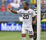 Jomal Williams (20) of Trinidad and Tobago flashes a thumbs up to a teammate for a good pass even though Williams missed his shot on goal against Guyana during their Gold Cup match on June 26, 2019 at Children's Mercy Park in Kansas City, KS.<br /> Tim VIZER/AFP