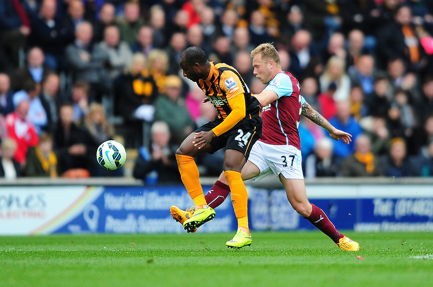 Burnley's Scott Arfield vies for possession with Hull City's Sone Aluko<br /> <br /> Photographer: Chris Vaughan/CameraSport<br /> <br /> Football - Barclays Premiership - Hull City v Burnley - Saturday 9th May 2015 - Kingston Communications Stadium - Hull<br /> <br /> &copy; CameraSport - 43 Linden Ave. Countesthorpe. Leicester. England. LE8 5PG - Tel: +44 (0) 116 277 4147 - admin@camerasport.com - www.camerasport.com